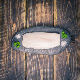 Cod loin fillet on a slate background