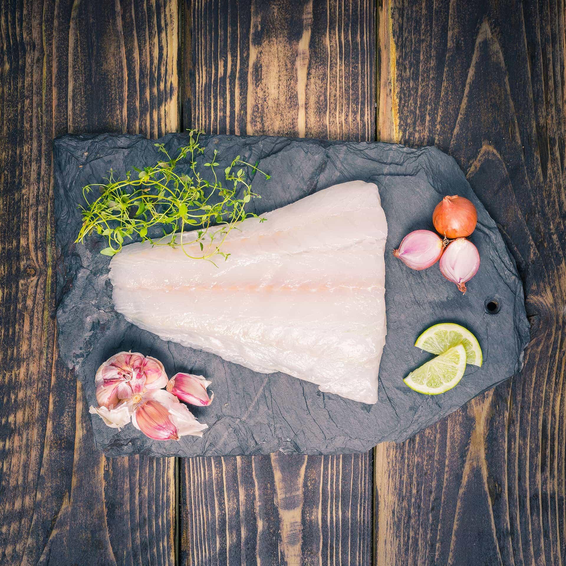 Cod steak on a slate background