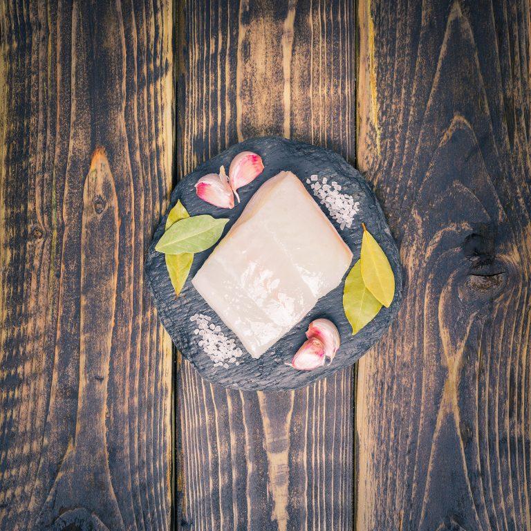 Halibut fillet on a slate background