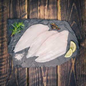 lemon sole fillets on a slate background