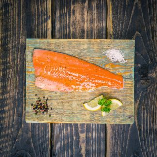 lemon and coriander trout fillet on a chopping board