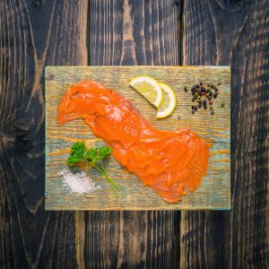 Smoked salmon slices on a chopping board