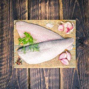 Sea bass fillets on a chopping board