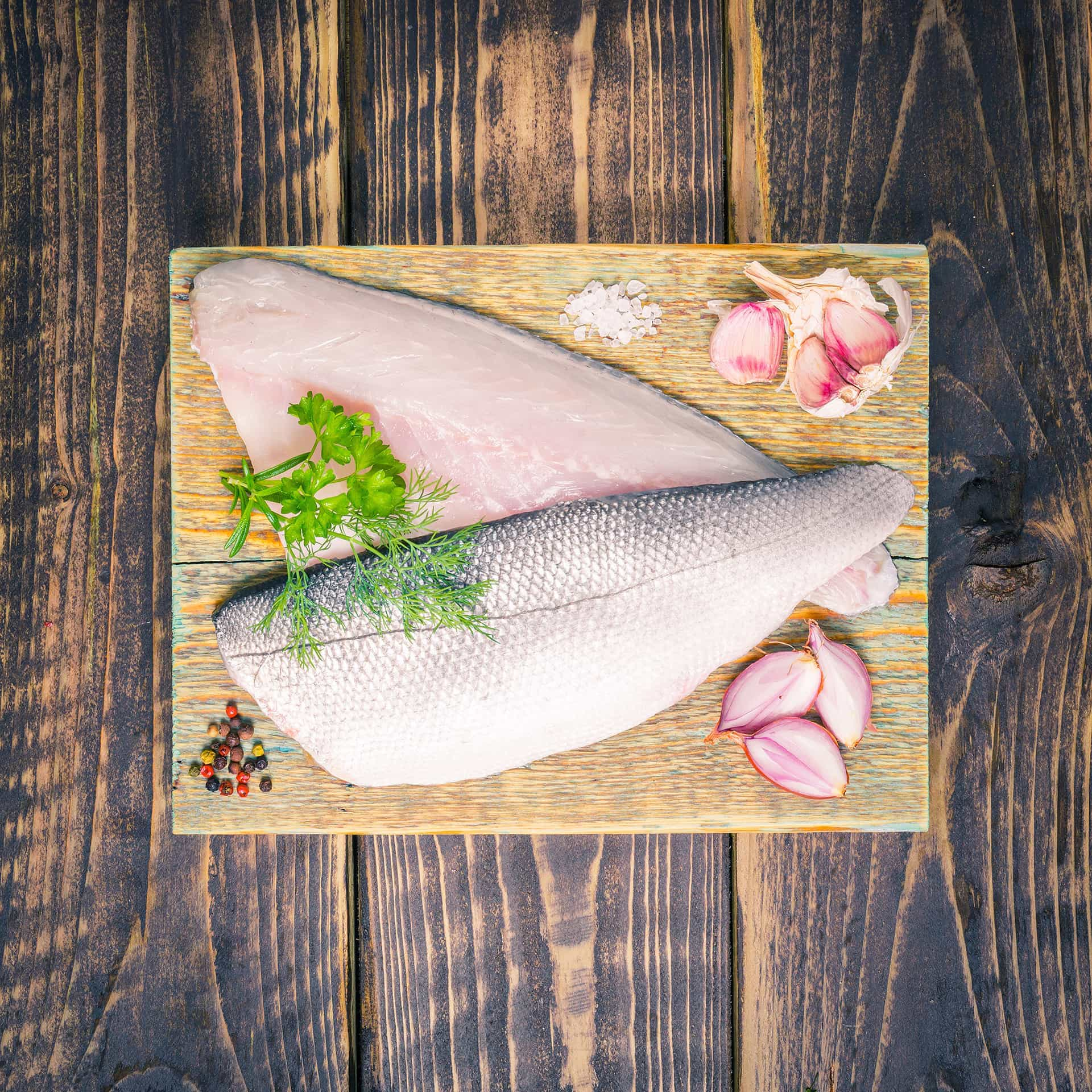 Sea bass fillets on a chopping board