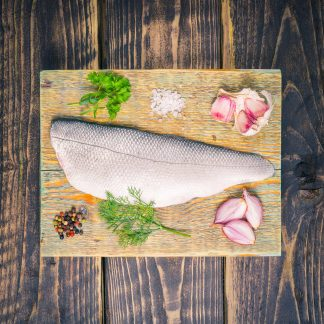 Sea bass fillet on a chopping board