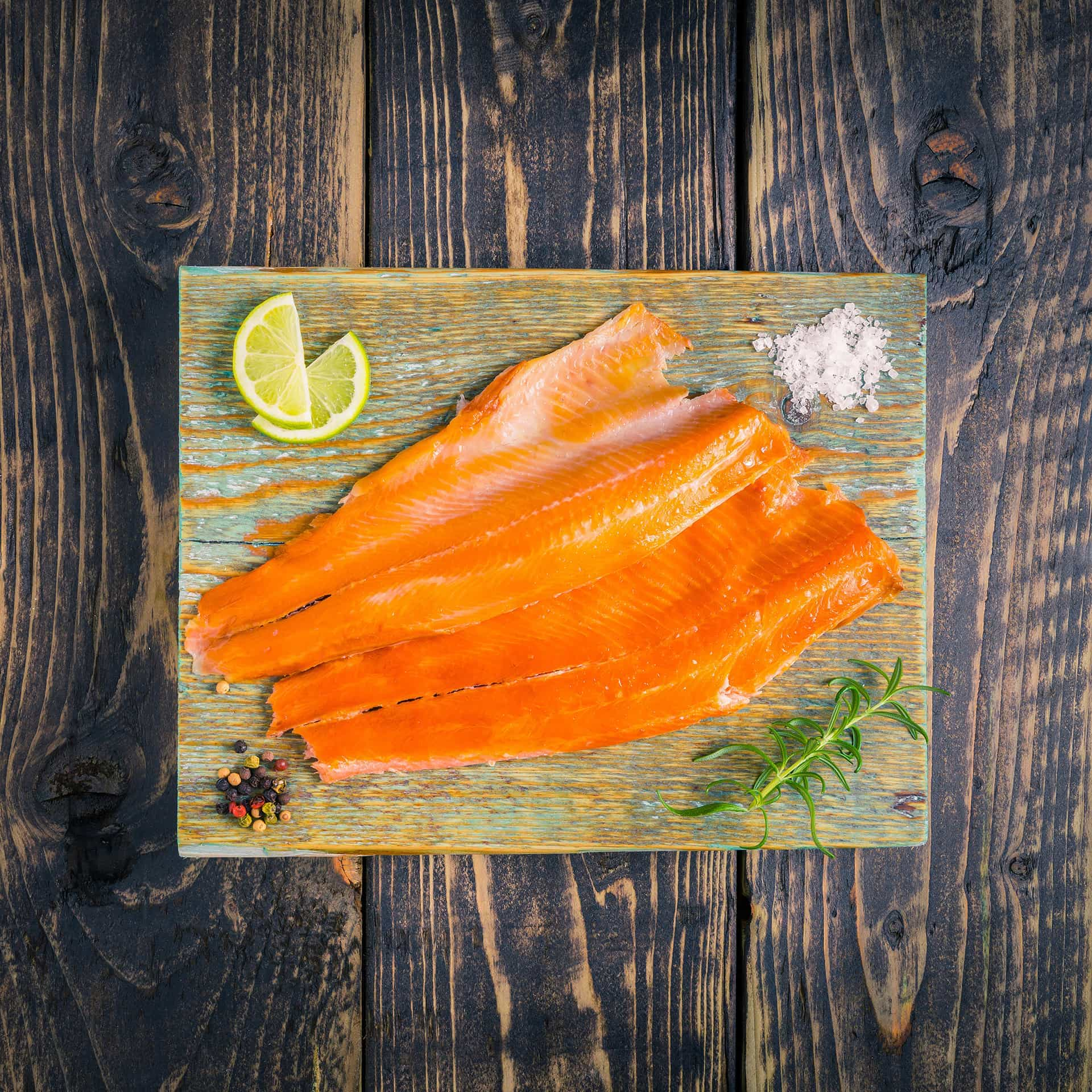 Smoked trout fillets on a chopping board