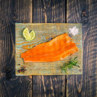Smoked trout fillet on a chopping board
