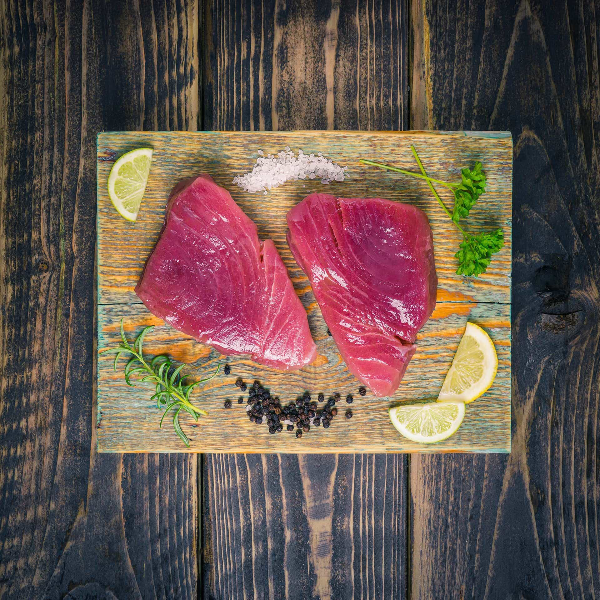 Tuna steaks on a chopping board