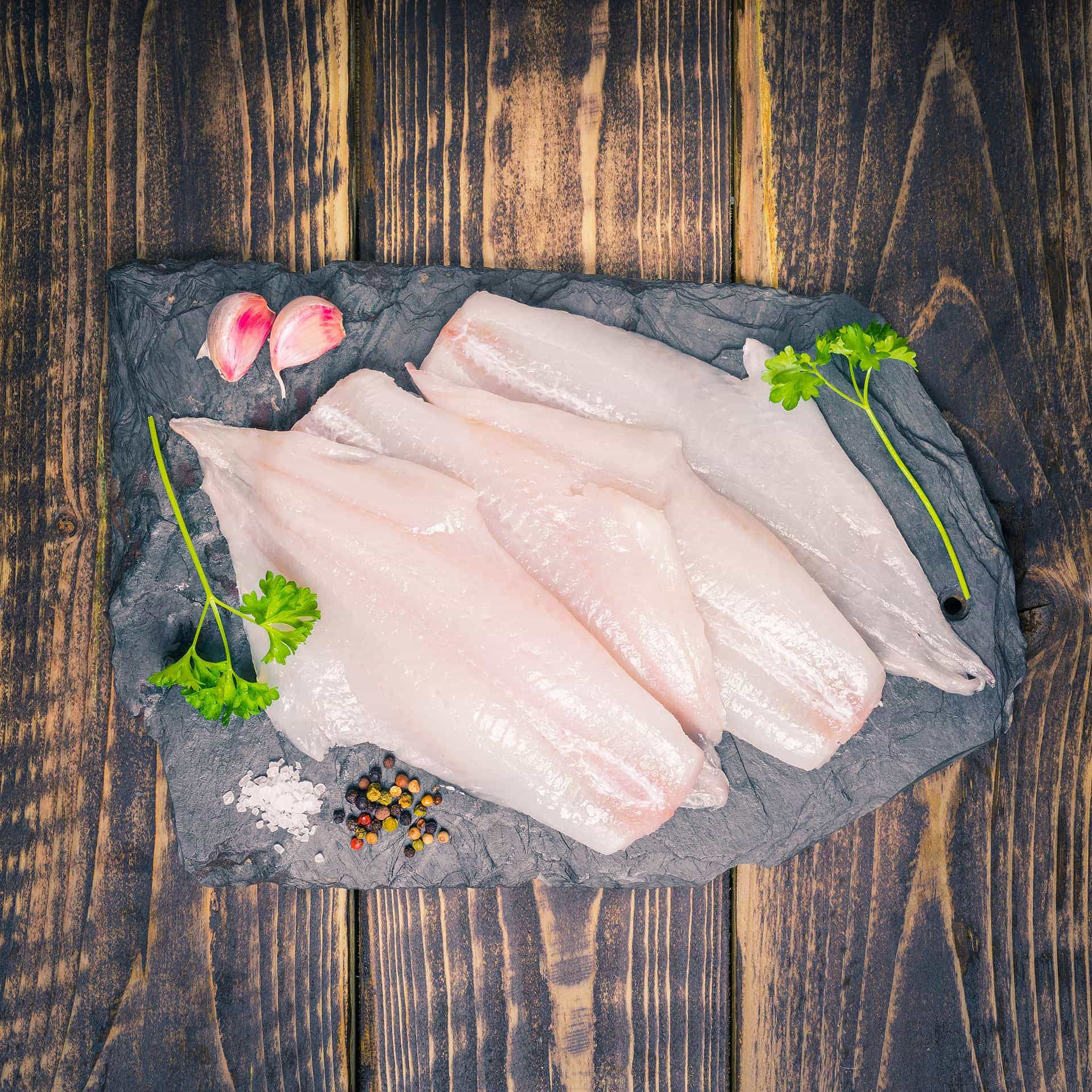 Haddock fillets on a slate background