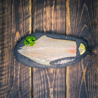 Peat smoked haddock fillet on a slate background