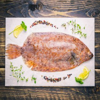 Whole lemon sole on a stone background