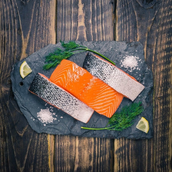 Salmon fillets on a slate background