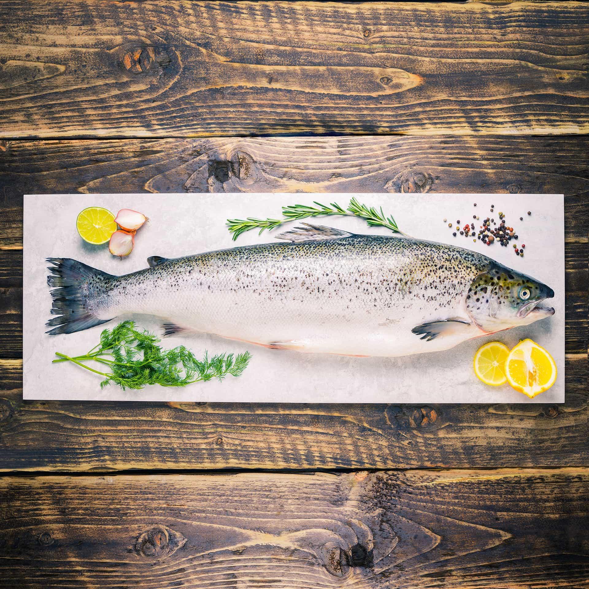 Whole salmon on a stone background