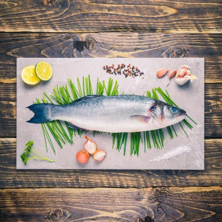 Whole sea bass on a stone background
