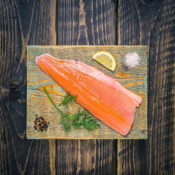 Trout fillet on a wooden chopping board