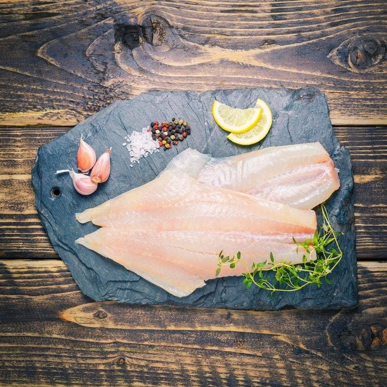 Peat-smoked haddock fillets on a slate background